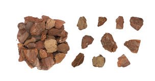 Heap Of Pine Tree Bark Chip Isolated. Heap of dry pine tree bark pieces isolated on white. Broken woods nature chip stock photo