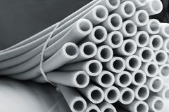 Heap of pipes. Heap of insulation for pipes closeup royalty free stock images