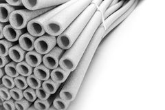 Heap of pipes. Heap of insulation for pipes isolated on white Royalty Free Stock Photos