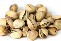Heap of pistachio nuts isolated on white background close up. Macro Royalty Free Stock Images