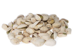 Heap of Pistachios on white Royalty Free Stock Images
