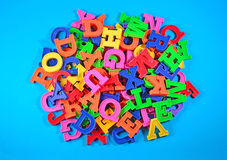Heap of plastic colored alphabet letters Stock Photo