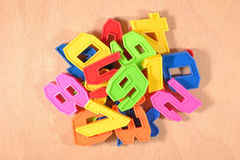 Heap of plastic colored numbers Royalty Free Stock Photos