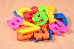 Heap of plastic colored numbers Stock Photography