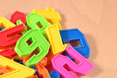 Heap of plastic colored numbers Royalty Free Stock Images