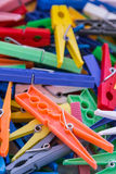 Heap of plastic laundry clothespin in vivid colors Royalty Free Stock Photo