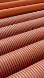 Heap of plastic ribbed tubes Royalty Free Stock Photos