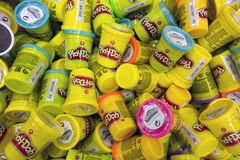 Heap of Play-Doh containers with difrent color  modeling compoun Royalty Free Stock Photography