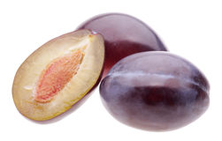 Heap plums. On white background Stock Photo
