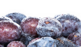 Heap of Plums with water drops on white Stock Photo