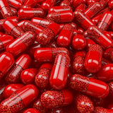 Heap, pool of red capsules, tablets, pills filled with heart shaped pills, pearls, medicine Stock Photo