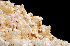 Heap of popcorn. Isolated on black background. on a diagonal Stock Photography