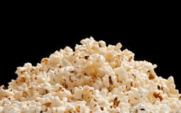 Heap of popcorn. Isolated on black background Royalty Free Stock Image