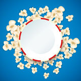 Heap popcorn for movie lies on blue background. Stock Image