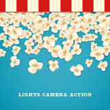 Heap popcorn for movie lies on blue background. Stock Photography