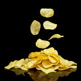 Heap of potato chips with falling chips Royalty Free Stock Photo
