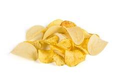 Heap of potato chips. Isolated royalty free stock photo