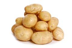 Heap of Potato on white stock images