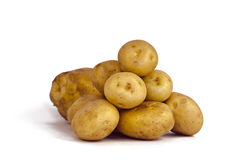 Heap of Potatoes. Isolated on white Stock Photos