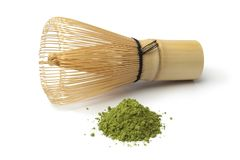 Heap of matcha tea and a whisk. Heap of powdered green matcha tea and chasen on white background Stock Images