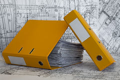 Heap of project drawings in yellow folder. royalty free stock photography