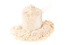 Heap of protein powder. With plastic spoon on white background stock photography