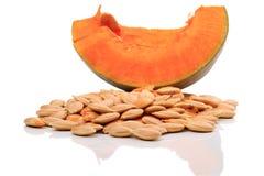 Heap pumpkin seeds on a white Royalty Free Stock Photos