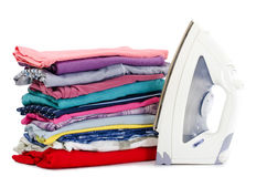 Heap of pure clothes with iron Royalty Free Stock Photography