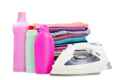 Heap of pure clothes with iron Royalty Free Stock Photos