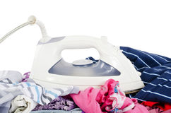 Heap of pure clothes with iron Stock Photography