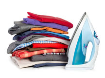 Heap of pure clothes with an iron Stock Images