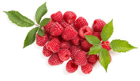 Heap of raspberry. Fresh organic fruit - top view of raspberry with green leaves isolated on white background royalty free stock photography