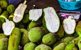 Heap of raw and cut kathal jackfruit echor in retail vegetable super market for sale.  Stock Photography