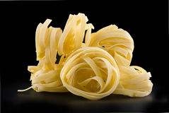 Heap raw dry nest pasta Royalty Free Stock Images