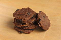Heap of raw food flax cookies with raisins (six pieces) Royalty Free Stock Photos