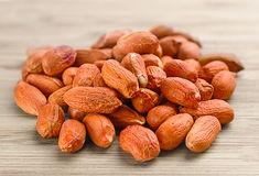 Heap of raw peanuts on the wooden background Royalty Free Stock Images