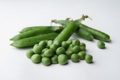 Heap of raw peas isolated on white background royalty free stock photography