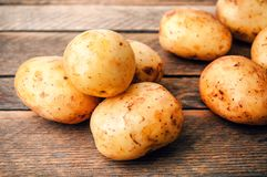 Heap of raw potato roots stock images