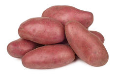 Heap of raw red potatoes isolated on white. Background stock photography