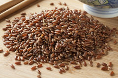 Heap of raw red rice Stock Images