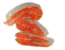 Heap of raw salmon pieces. Isolated on white Stock Photos