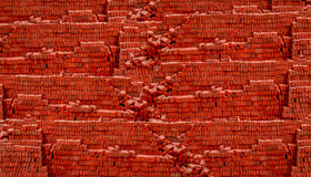 Heap red brick at construction site. With blank space for texts display stock images