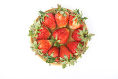 A heap of red fresh strawberries in a dish, isolat. A heap of red fresh strawberries isolated on white Stock Photo