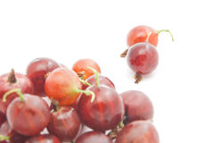 Heap of red gooseberries. On white background Royalty Free Stock Photos