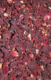 Heap of red herbal tea. Dried petals of hibiscus Stock Photography