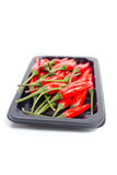 Heap of red hot chili pepper. Heap of red hot chili pepper in black container isolated on white background Stock Photo