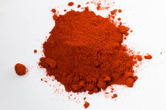 Heap of red pepper powder isolated on white background Royalty Free Stock Images
