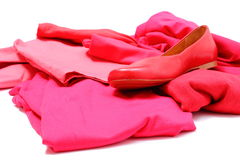Heap of red and pink clothes with womanly shoes Stock Image