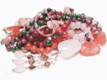 Heap of red and pink colored beads Royalty Free Stock Photography