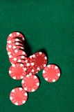 Heap of red poker chips on the green table Stock Photography